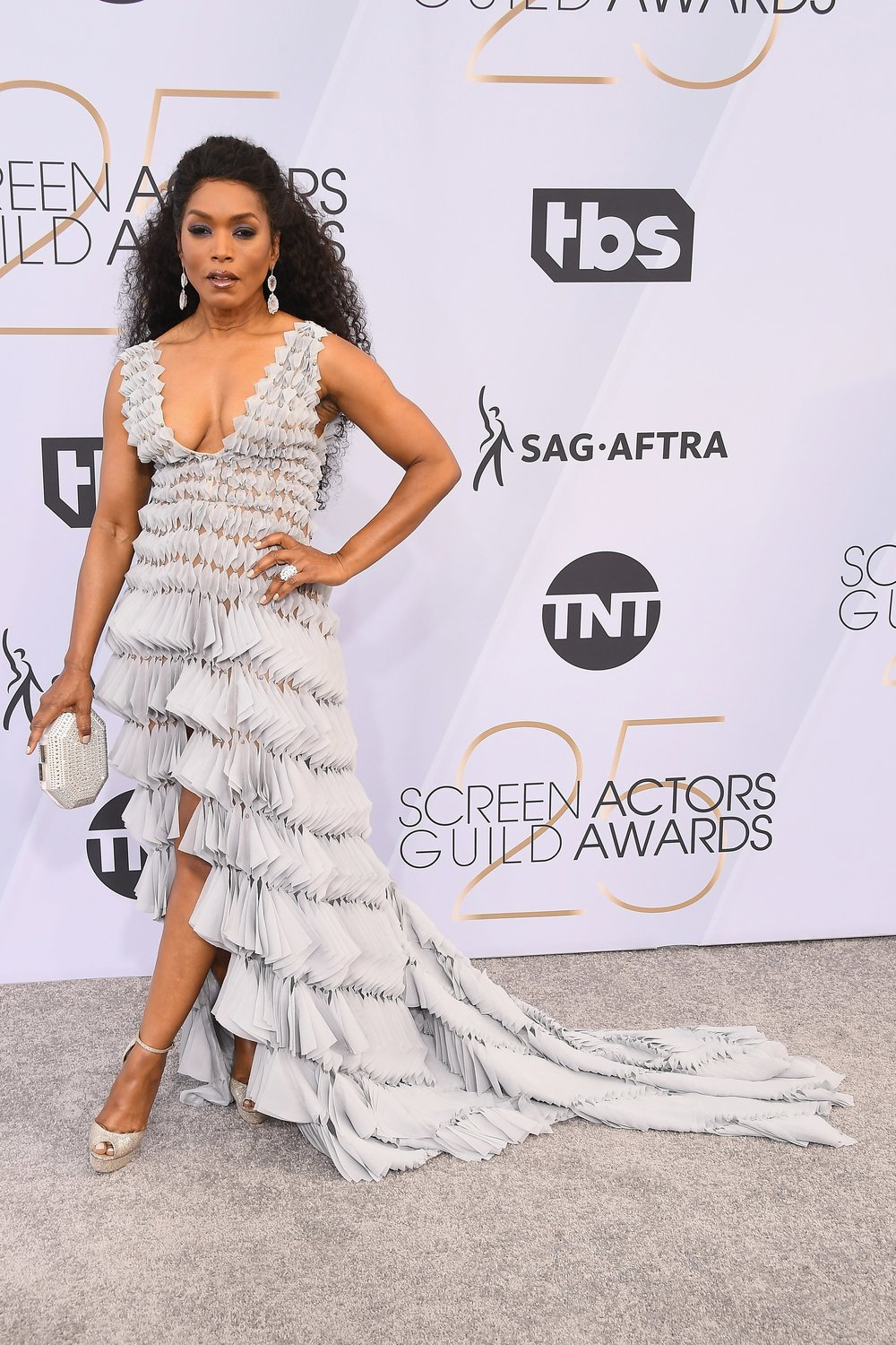 - Angela Bassett in Georges Chakra, Casadei shoes, a Tadashi Shoji Clutch, and Kimberly McDonald jewelry