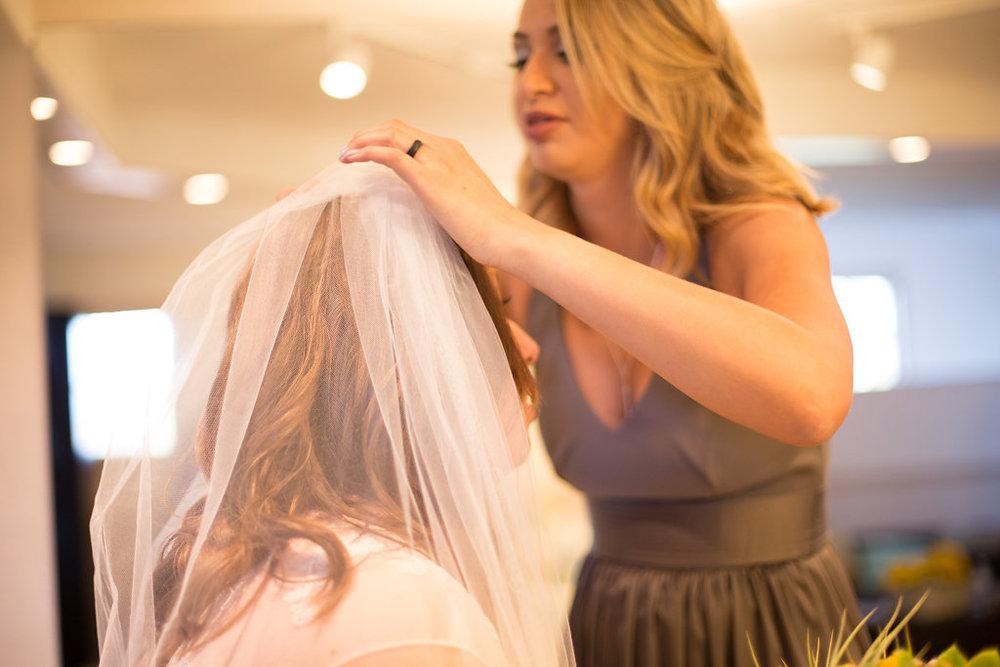 bridesmaid getting bride ready