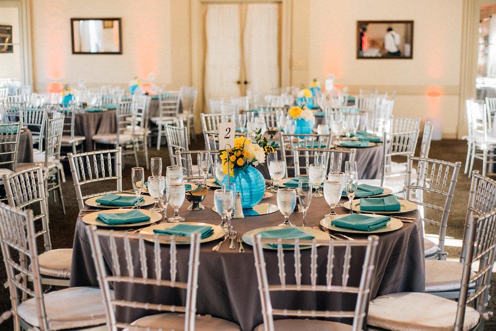 wedding table setting with grey linen