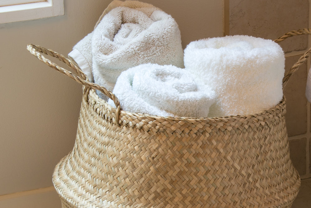 luxury gift basket in bathroom with towels