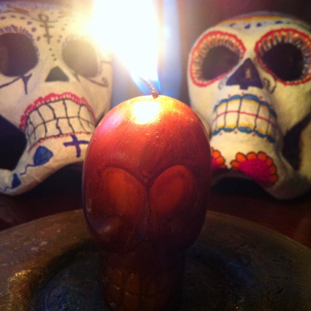 Twin skulls and candle