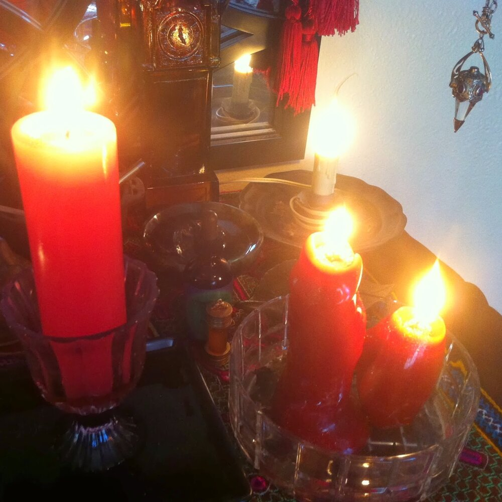 Multiple candles on an altar