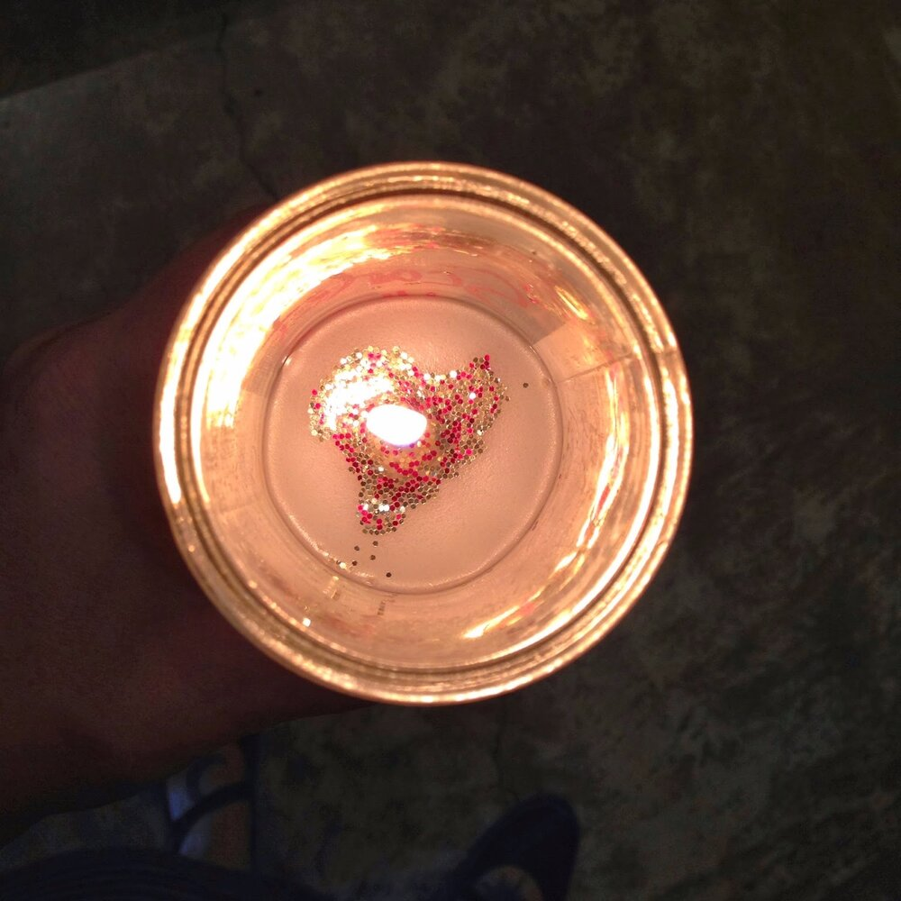 Close up of candle flame, glitter formed a heart by itself