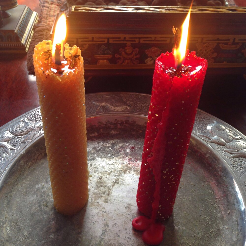 Hand-rolled beeswax candles for love and money.