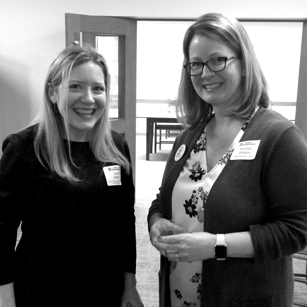 Laura Martin, AHS board member and associate pastor at Rock Spring Congregational UUC, and AHS executive director Michelle Winters greeted attendees of the Faith & Housing Roundtable October 28.