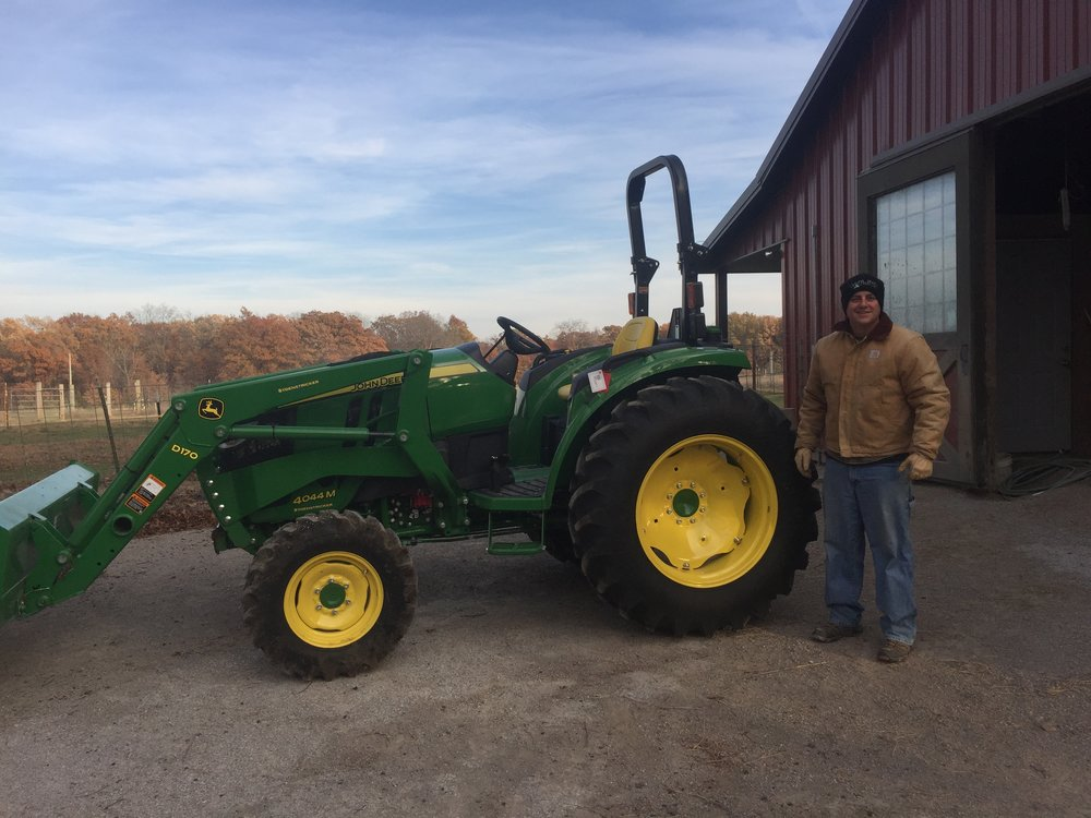Brandt fulfilling a dream with his very first tractor.