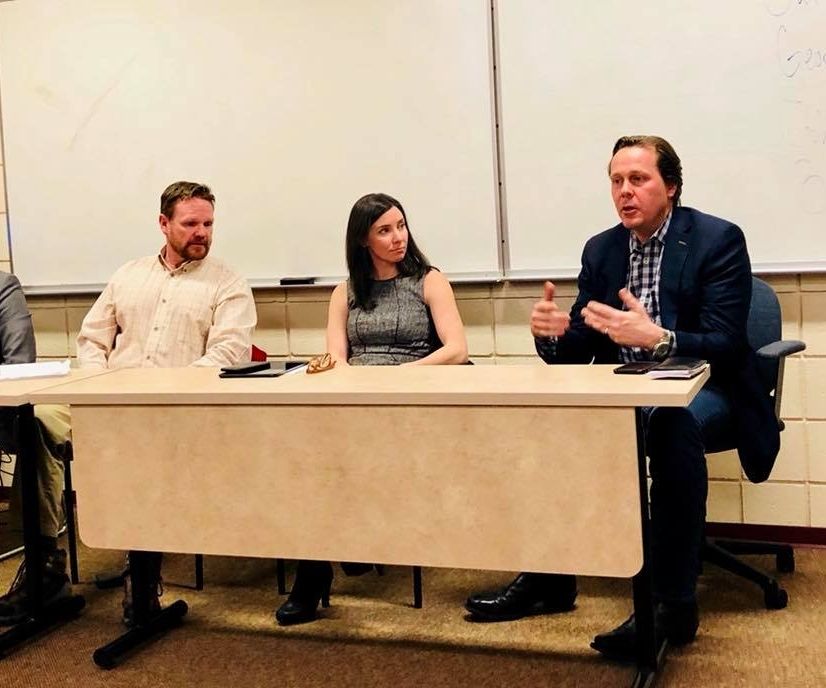 Brian speaking on a panel at Denver University