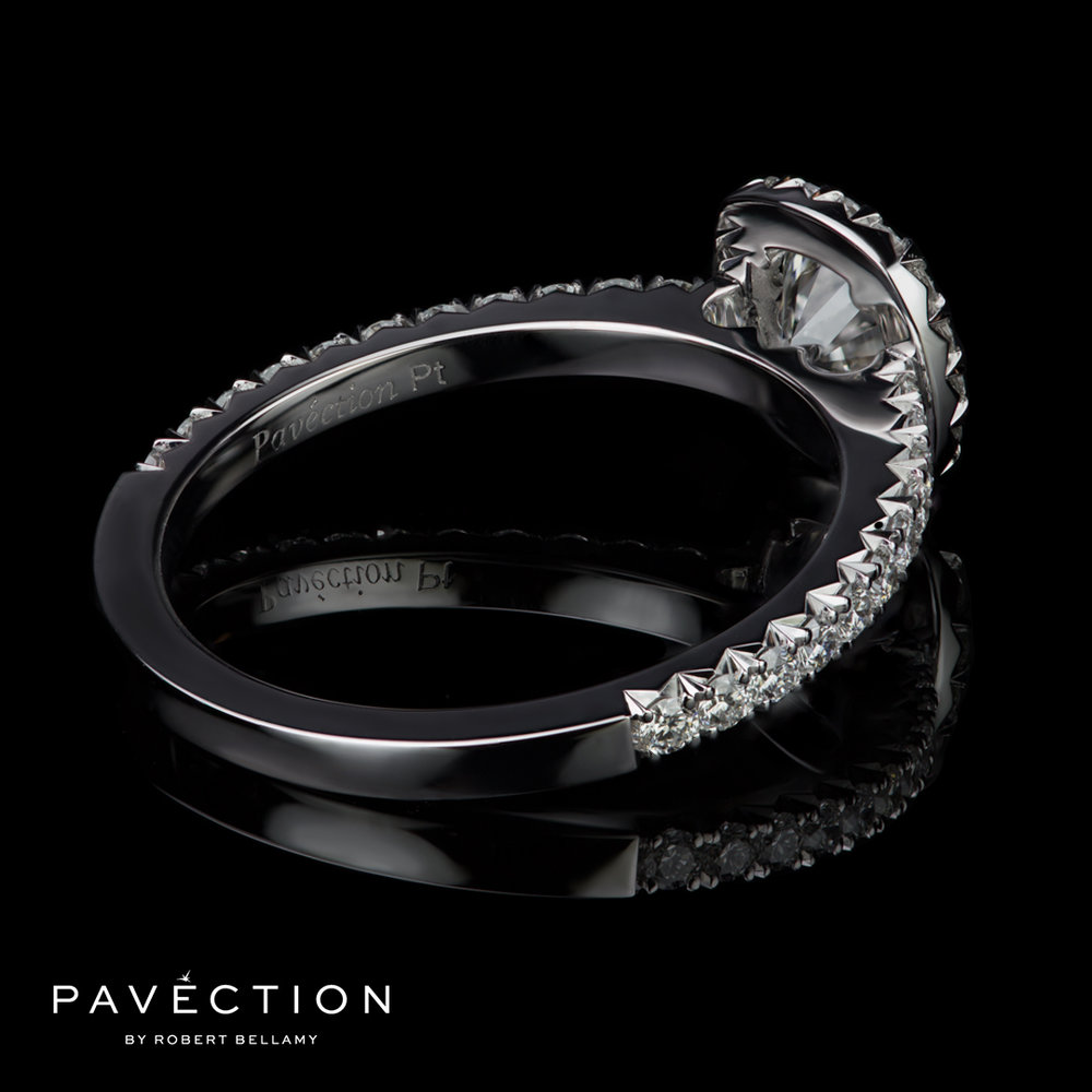 D vvs1 cushion cut diamond and platinum halo engagement ring.jpg