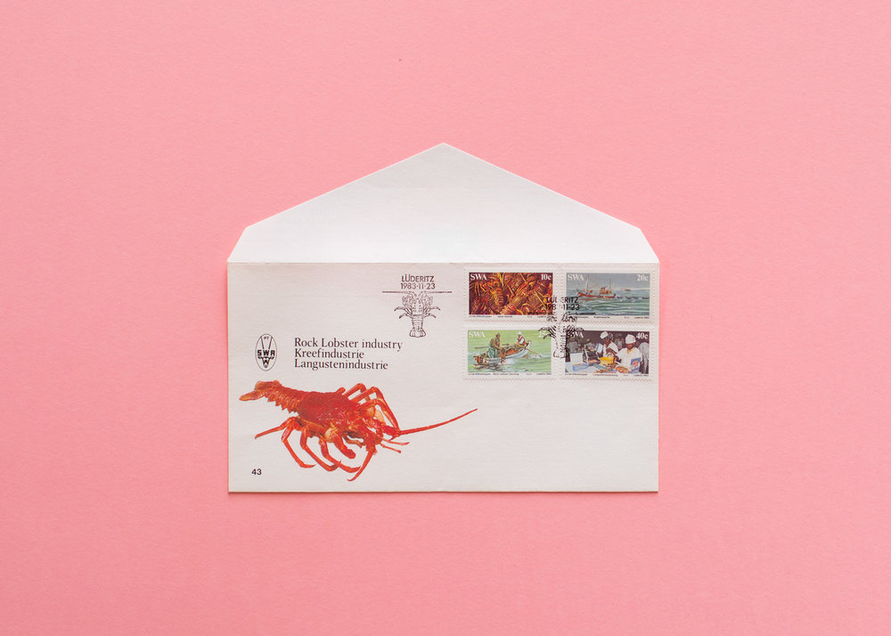Envelope with lobster detail and lobster themed stamps.