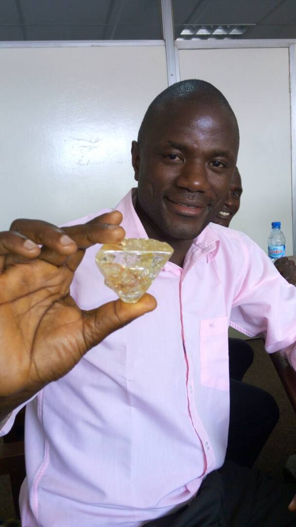 Pastor Emmanuel Momoh (owner of the diamond) and the 709ct. Diamond