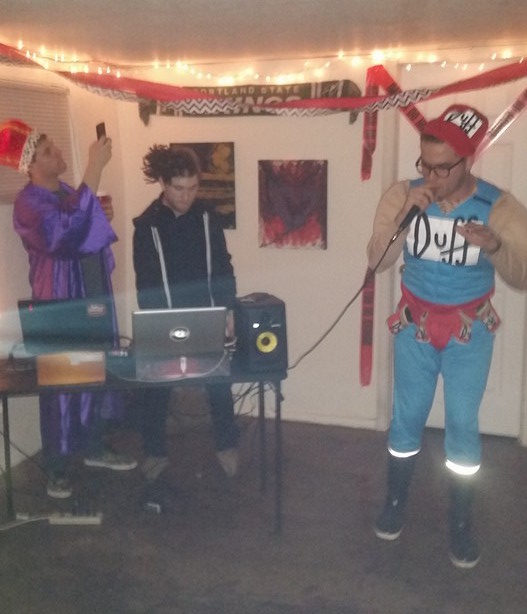 Performing at a house show dressed as Duff Man for Halloween