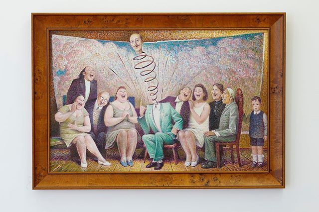 """Now we also show modern artists. There is plenty to see and discover in the art of Auseklis Baušķenieks, especially of the late soviet period. """"Blēņu stāsti"""" (Boloney stories) shows the split reality between socialized adult behaviors and a worldview of a child. Yes, it might look like an entertaining scene at first, yet we get suspicious over the fact that these people are sitting in front of a painted screen. Are they really just pretending to laugh and whom are they trying to persuade by this action?  You see, Instagram ain't the first place where people are faking it."""