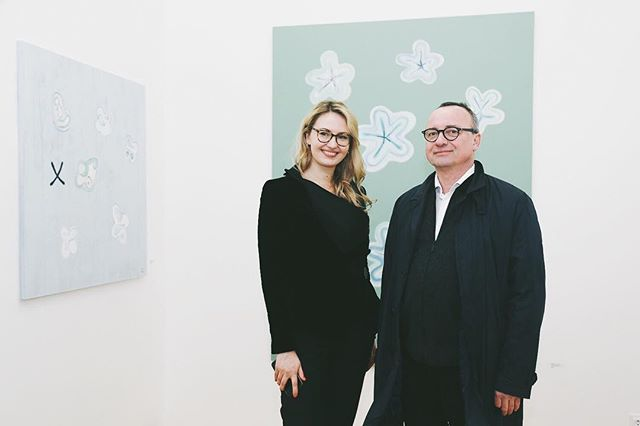 """At the gallery re-opening, artist Kaspars Zariņš with our founder Alise Careva. Currently we are showing two paintings from his new series """"Gene of happiness"""". He was the first artist that we exhibited and has a very special place in our hearts. It was quite brave to trust a woman with no gallery, no space, no employees, but lots of enthusiasm regarding the potential of Baltic artists. Paldies, Kaspar! @kaspars.zarins"""