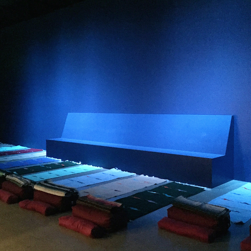 restorative yoga in the gallery at moca cleveland - Eastern philosophies and religious traditions such as Tibetan Buddhism, the mind and body's relationship to consciousness, and the fundamental structures of healing in the natural and human worlds underpin INDUCTION. Weaving sound, touch, and image in a low-lit, deep blue space, INDUCTION encourages awareness of the relationship and balance between body, mind, and spirit. MOCA is offering a series of Saturday morning classes led by area experts designed to support these reflective experiences and build mindfulness.RESTORATIVE YOGA:Join Gwendolyn Ren, certified Yoga Instructor of Cleveland's Abide Yoga for Restorative yoga. This passive practice is an aid for stiffness, anxiety, tension, busyness and insomnia it is also a practice of abiding that, integrated into our lives, can teach us about patience, observance and the profound effects of response versus reaction. Restorative Yoga aims to nurture the parasympathetic nervous system, by allowing space for relaxation and rest.