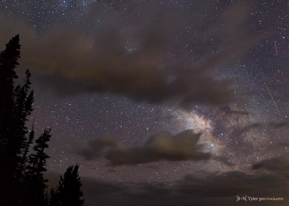 Milky way peaking through clouds