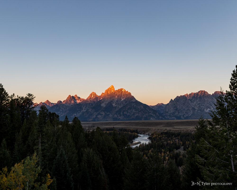 Sun on the tips of Grand Teton Range