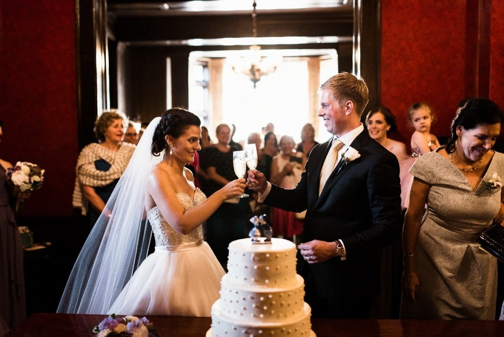 Bride and groom cutting cake at Minneapolis Club