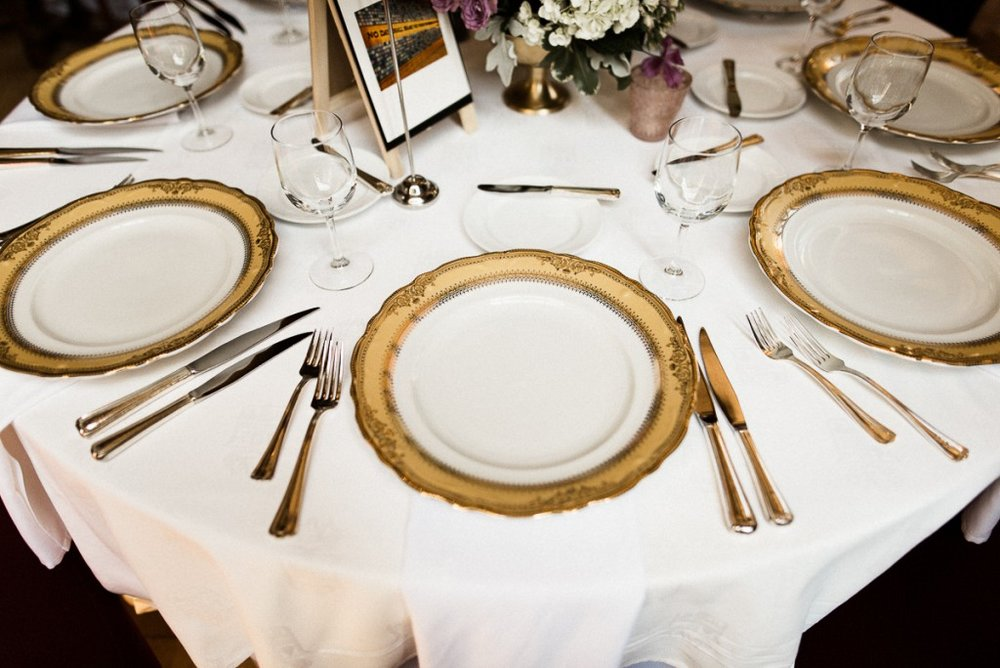 Vintage gold chargers, vintage inspired table setting at Wedding reception, wedding venue Minneapolis Club