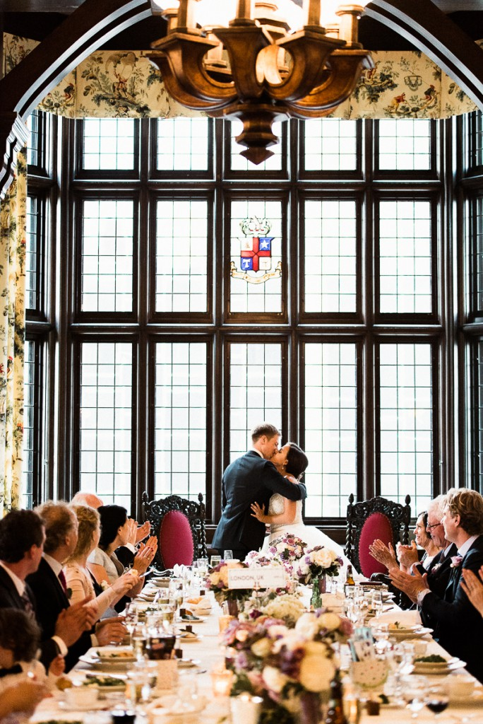 bride and groom kissing after toast at Minneapolis club