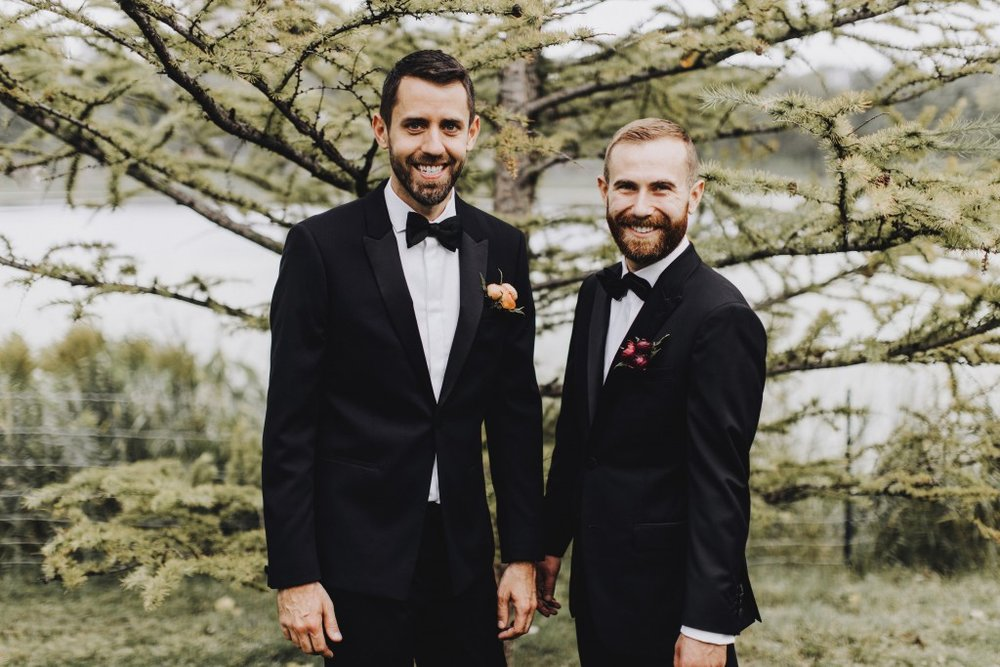 Groom's pose for photo for Linden Hills Minnesota wedding, same-sex wedding planner