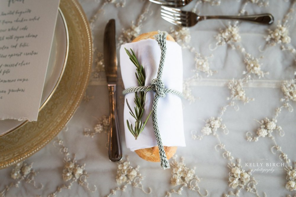 French bread wrapped in napkin at each place setting for Historic Hope Glen Farm wedding