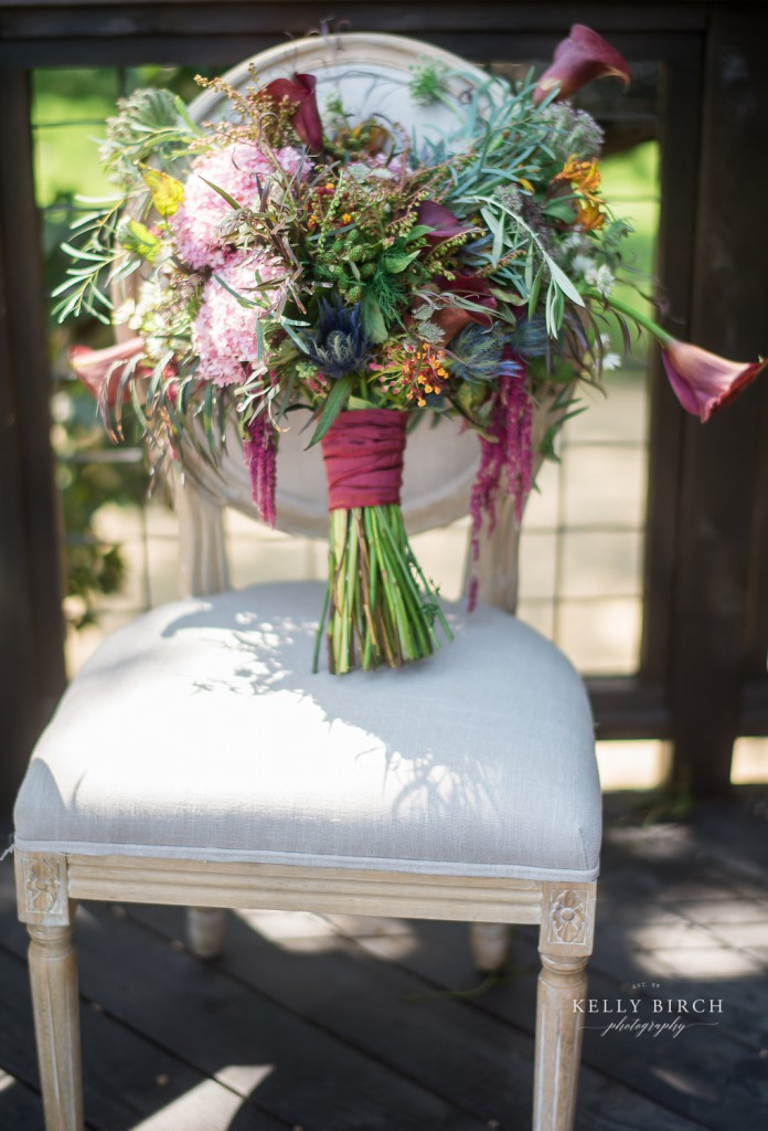 Bohemian inspired bouquet in pinks, blue, orange with wildflower accents
