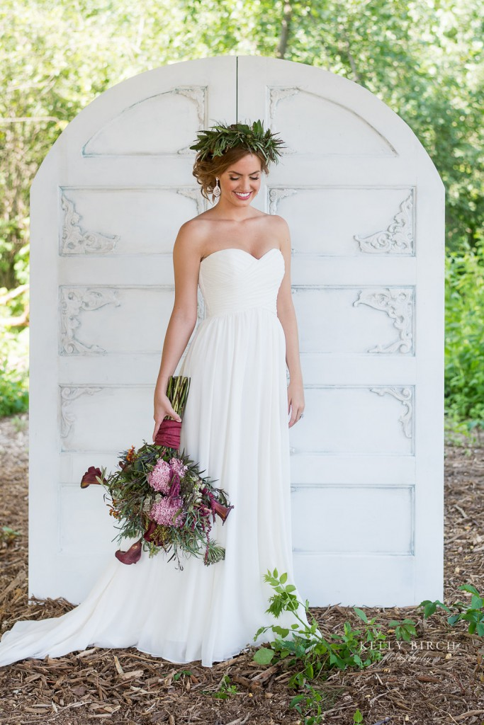 Bridal portait at Historic Hope Glen Farm. Boho inspired theme with vintage white door and pink wildflower bouquet