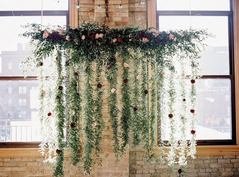 Floral installation with garland and fresh flowers for Day Block Event Center Wedding