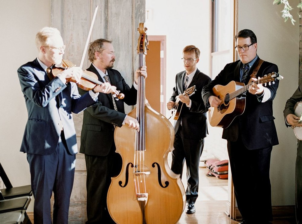 live musicians play string instruments at Day Block Day Center wedding in Minneapolis