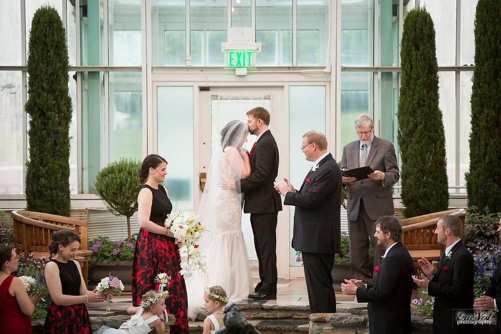 Bride and groom's first kiss for Como Park Zoo and Conservatory wedding ceremony