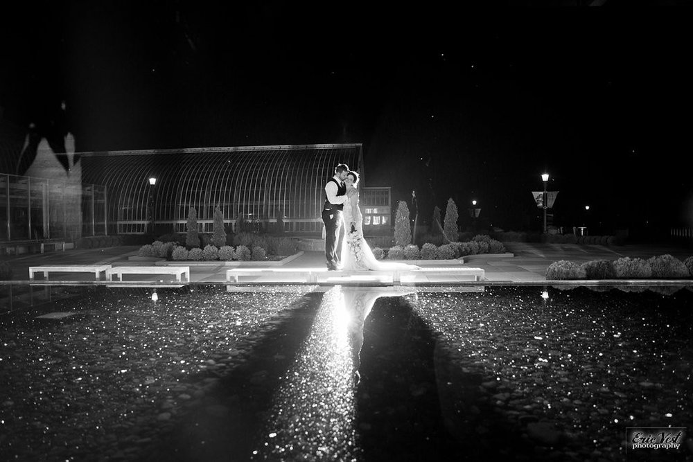 nighttime shot of bride and groom at Como Park Zoo and Conservatory