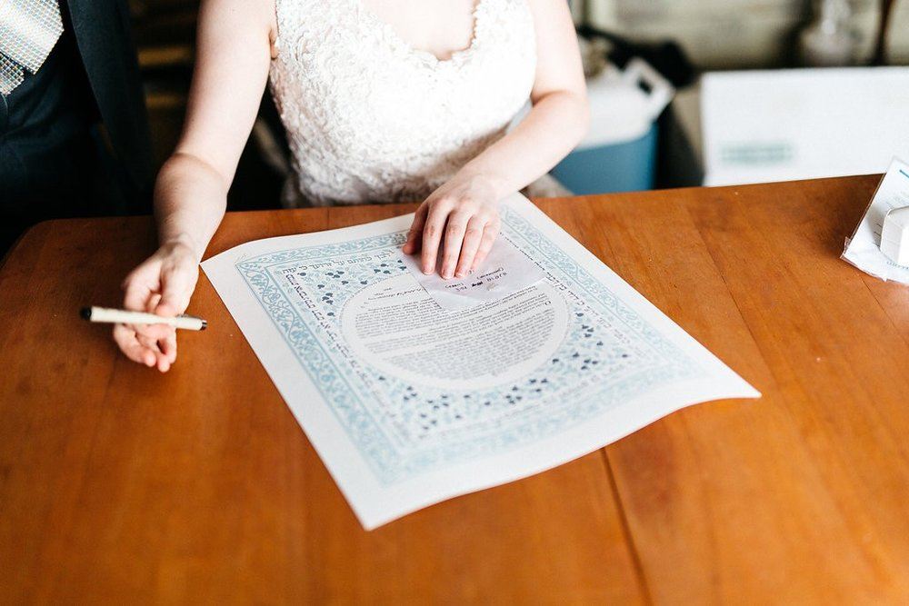 Bride signing of the Ketubah, Jewish wedding contract