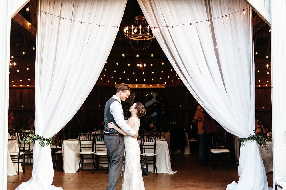 bride and groom at the end of daytime wedding reception at Red Barn Farm