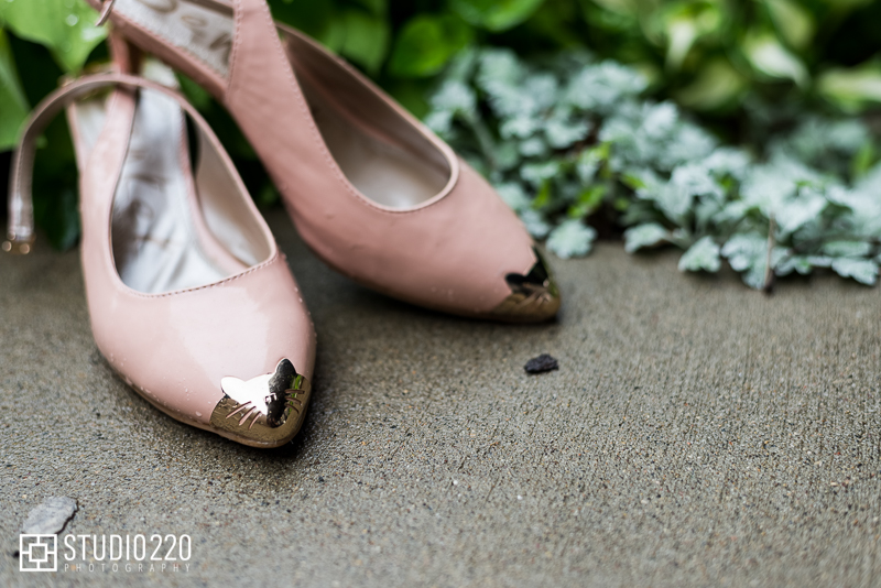 Blush wedding shoes with gold pointy cap toe