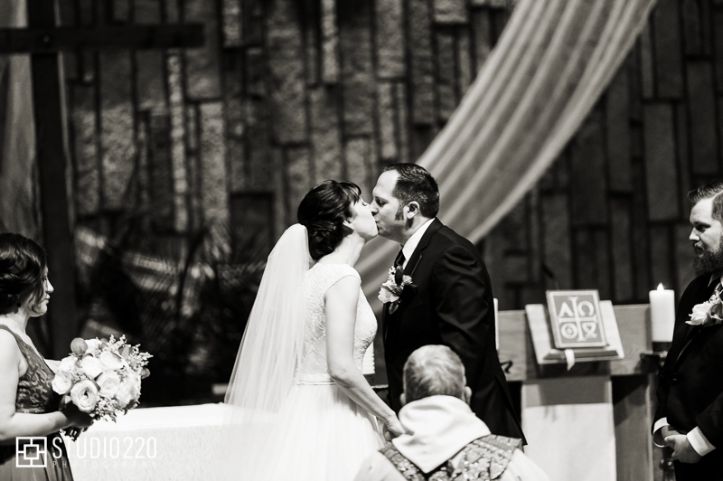 Pax Wedding ceremony kiss at Christi Catholic Community