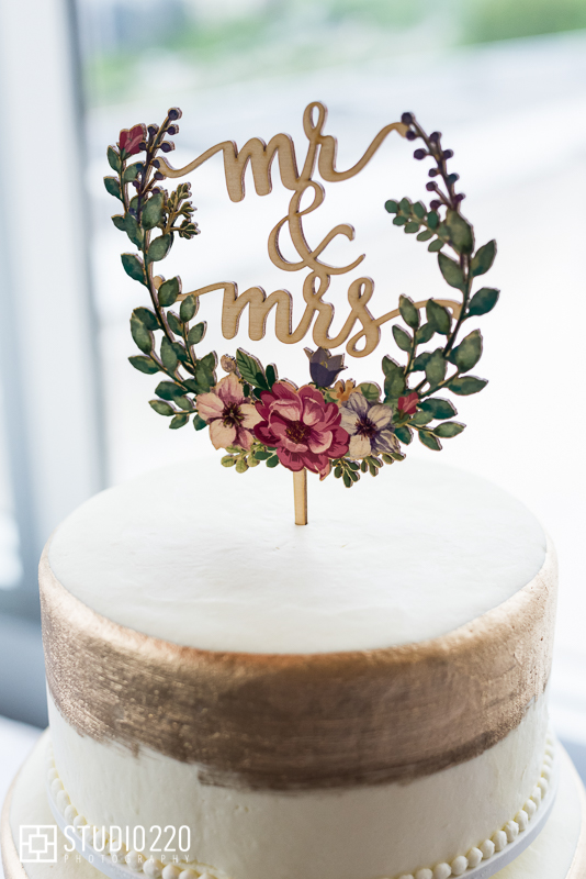 Gold painted cake with script topper