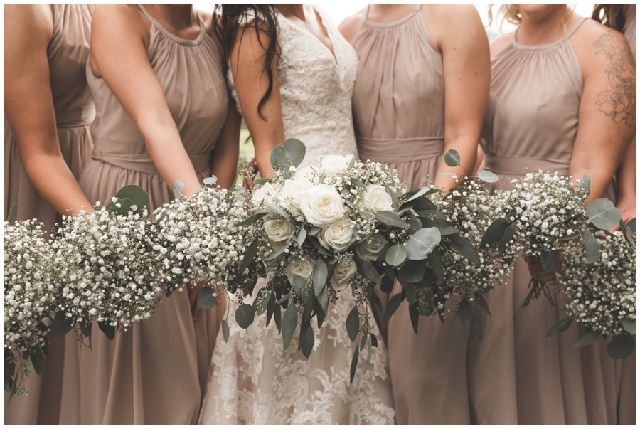 bride and bridesmaids white bouquets