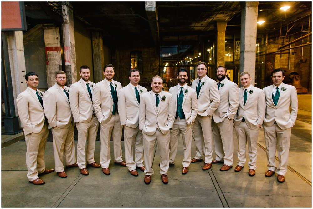 Groom and his groomsmen with greenery tie and boutonniere