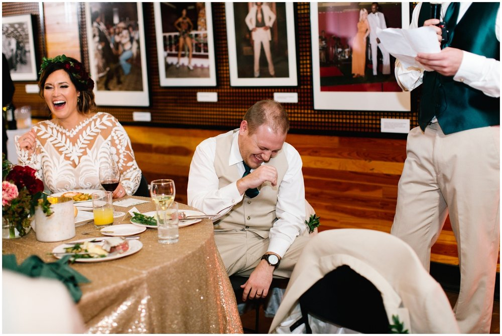 Bride and groom laughing at their wedding reception