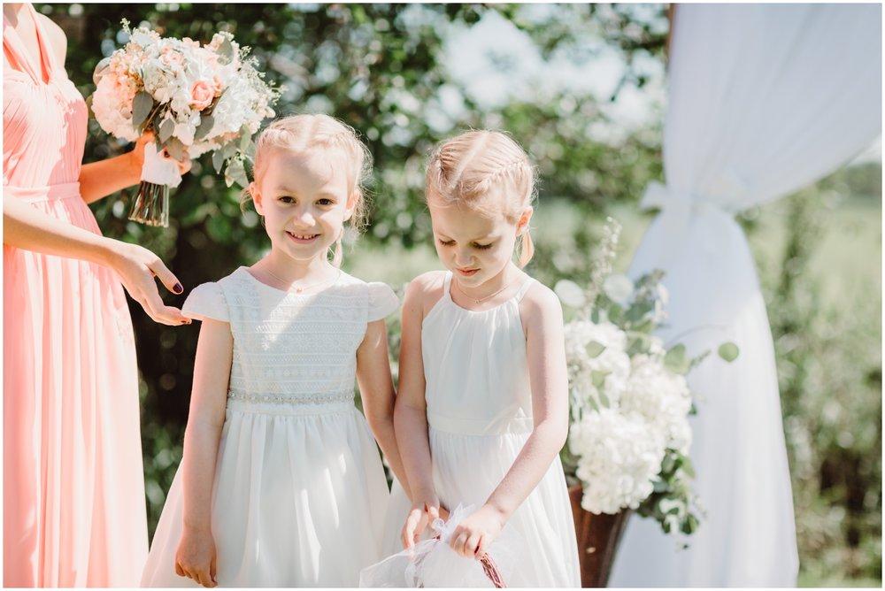 flower girls at an outdoor wedding in Minnesota