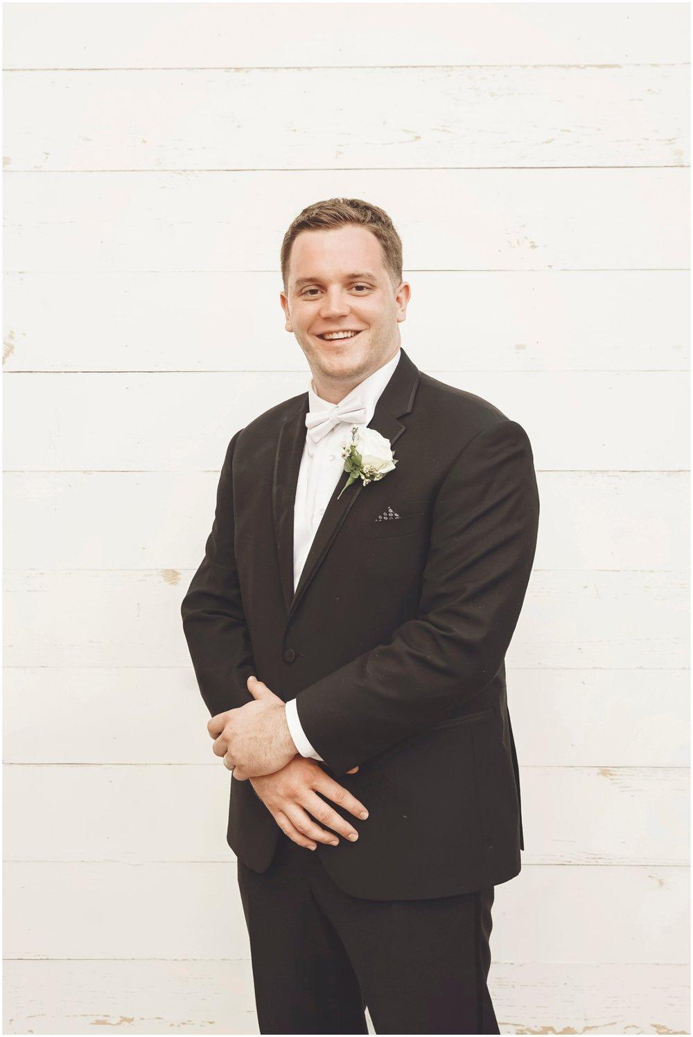 Groom before his Rustic wedding in WI