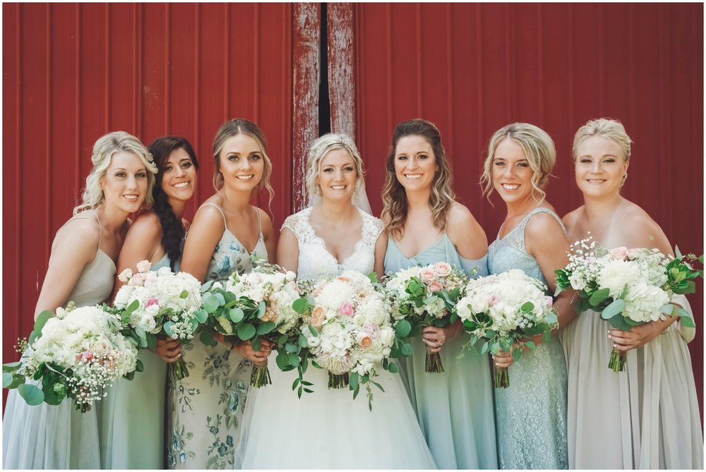 Bridesmaids and bride holding wedding bouquets