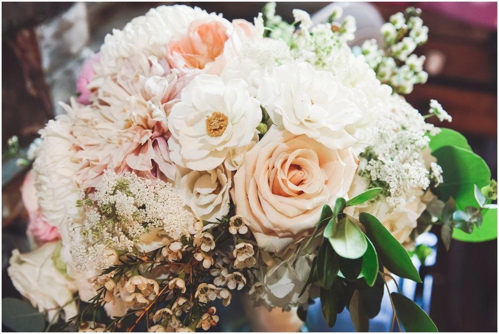 Peach and white bridal bouquet closeup
