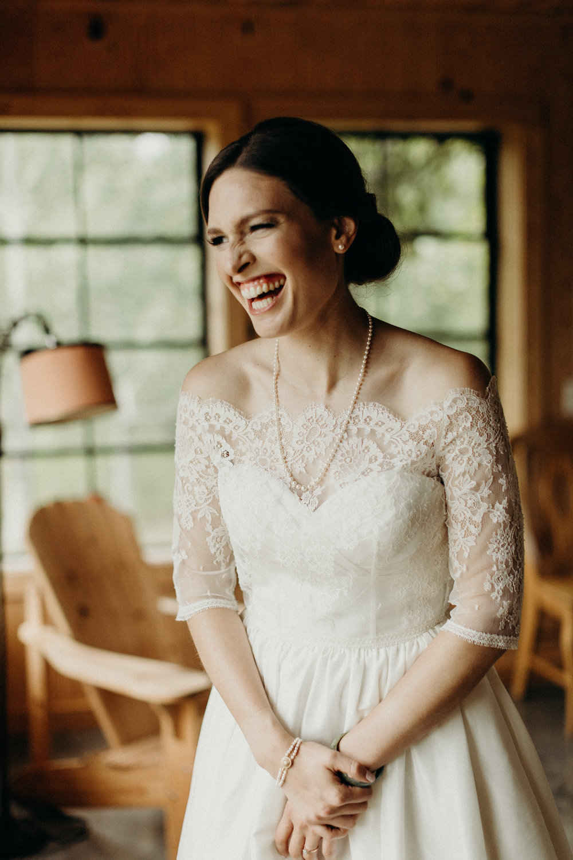 Bride smiling on her wedding dress
