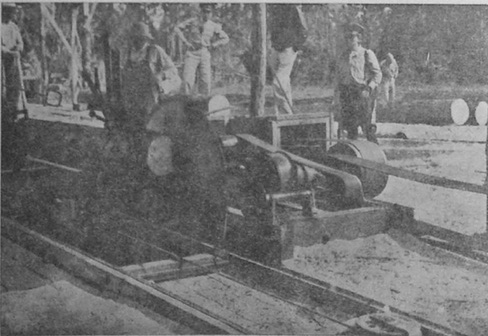 Officers inspecting a military operated sawmill in the Petén, circa 1950.