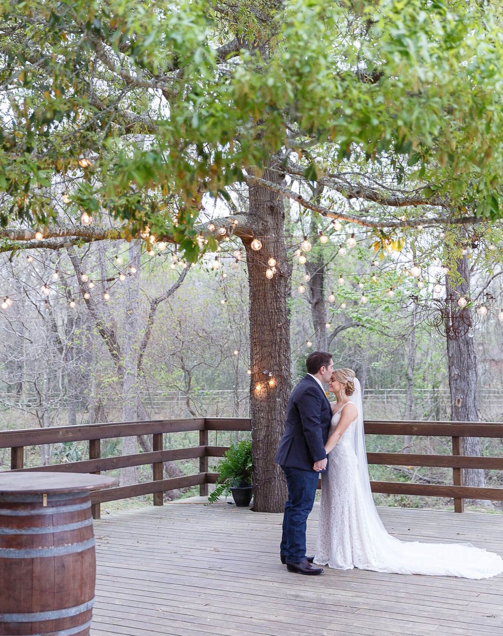 couple under patio tree married at the carriage house in conroe TX.jpg