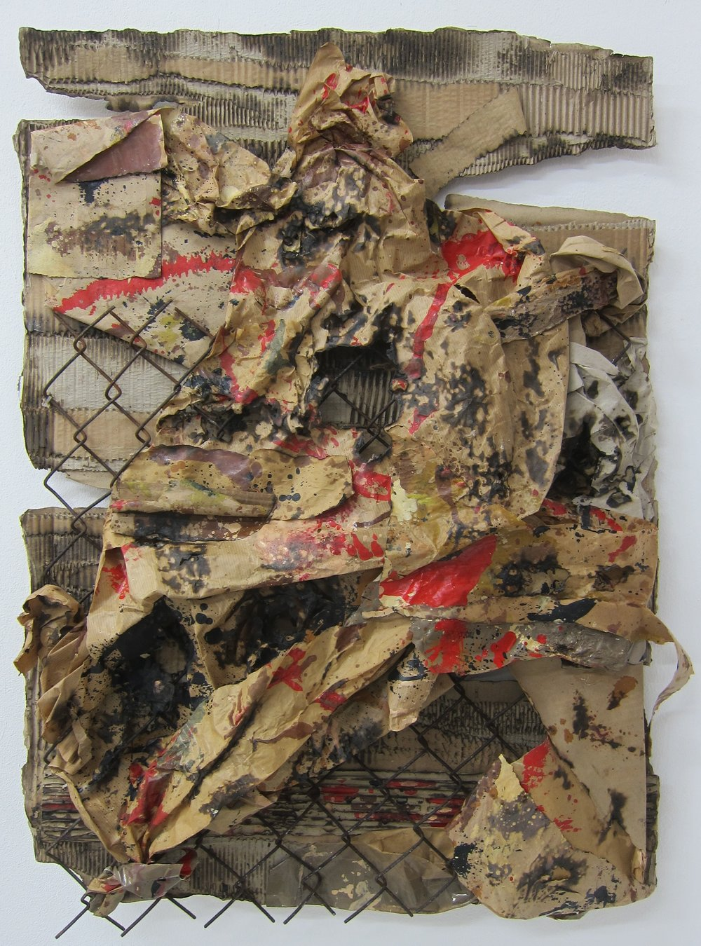 Womble Burner.   Cardboard, paper, alkyd resin, fence, fire and water.   80 x 58 cm.  2015.