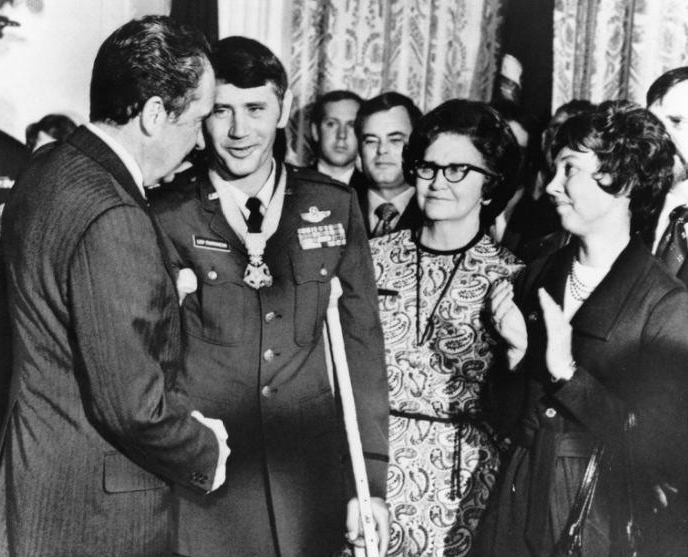 Leo Thorsness (POW at Hanoi Hilton for six years) receiveing his Medal of Honor on October 13, 1973 from President Richard Nixon