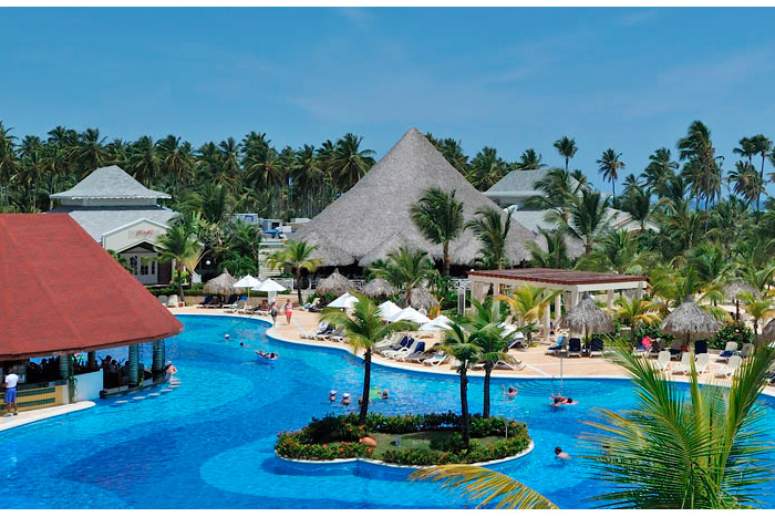 Spend time in Paradise-Grand Bahia Principe Bavaro, Punta Cana, Dominican Republic - Pricing example: July 15-19, 2019, $762/per person for a Junior Suite Room. Price includes airfare + 4 nights room accommodations.Airfare portion included in the pricing is based from a Los Angeles, Ca departure and 4 nights accommodations based on a Monday - Thursday stay. Other departing airport locations and check-in/check-out dates could be at a different price. Price shown includes all taxes and most fees.
