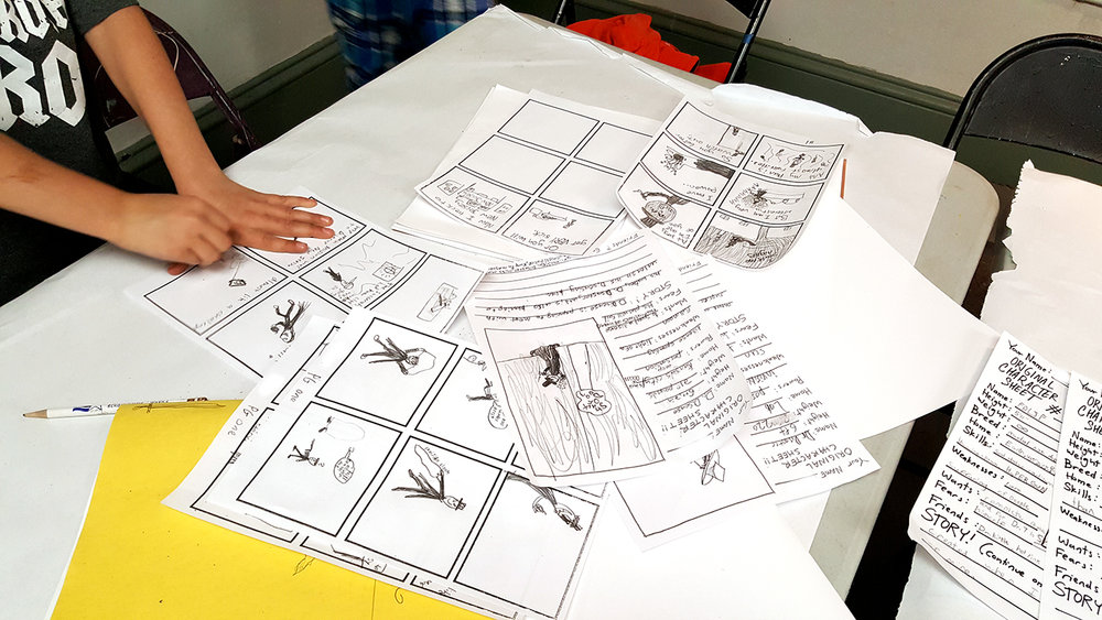 Students use their sketchbooks and worksheets to prep for their final stories.